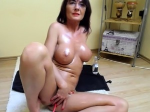 woman fingering and dildoing pussy